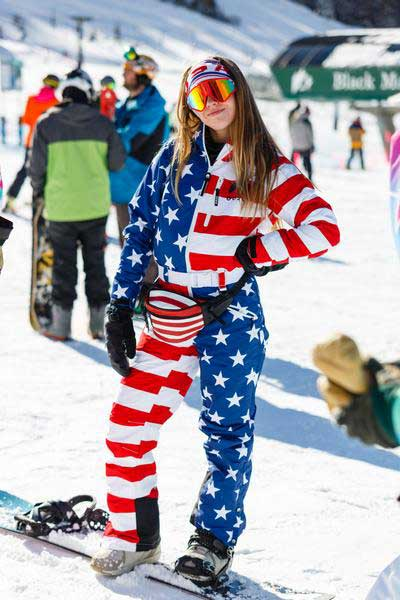 Woman in USA snowsuit