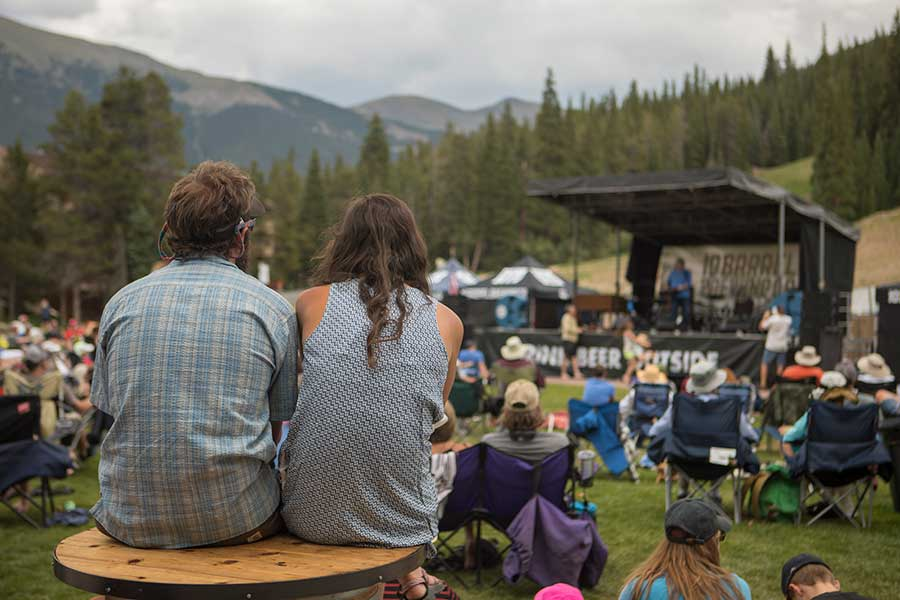 A couple watches a concert during the summer at Copper Mountain