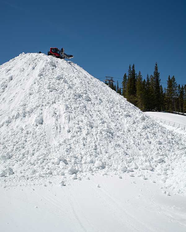 Nearly 80 feet of snow has been stockpiled already for the Woodward Copper Summer Camp terrain park