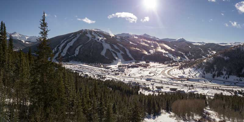 A birds eye view of Copper Mountain during winter from across Interstate 70